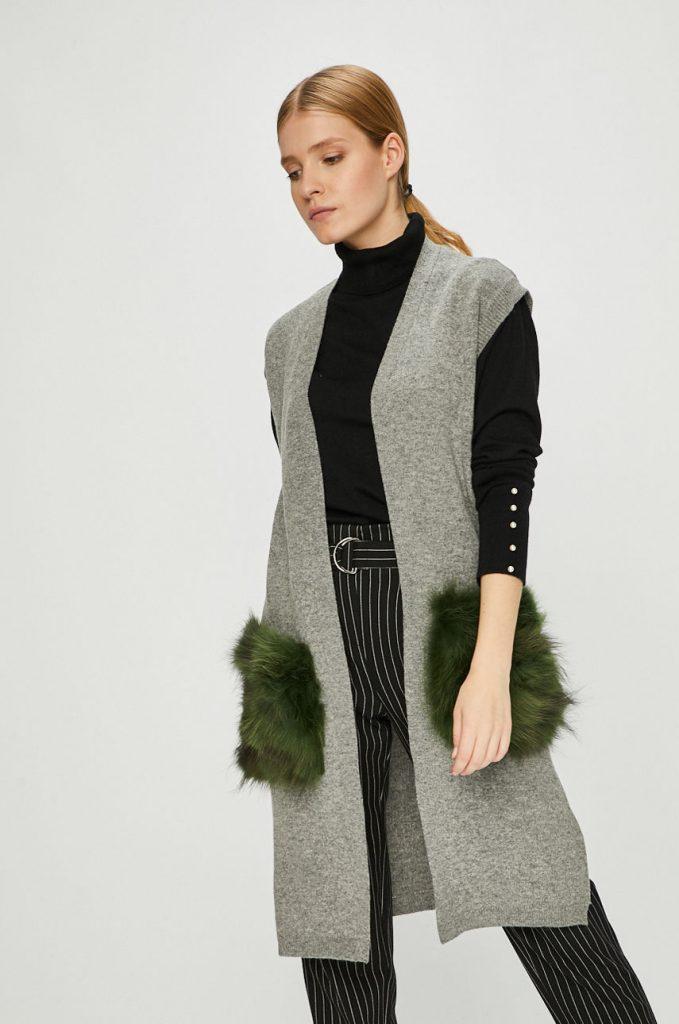 vesta tricotata cu buzunare din blana